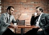 8726974-coffee-and-conversation-between-two-well-dressed-men